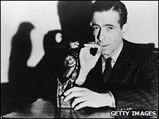 Humphrey Bogart smoking, in a scene from The Maltese Falcon