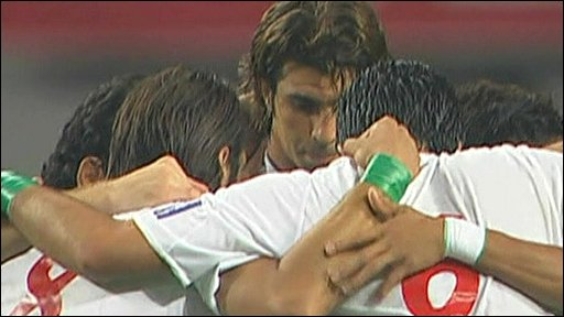 Members of the Iranian football team wearing green wristbands