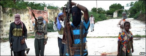 Somali Islamist insurgents patrol a street in the Tarbunka area of Mogadishu on 17 June 2009