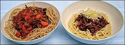 Two bowls of spaghetti bolognese