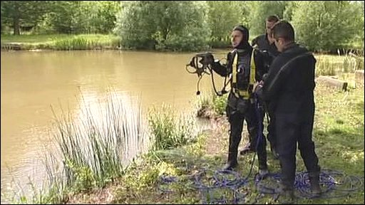 Police divers search a lake at Burridge, near Fareham