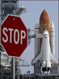 Space Shuttle Endeavour prepares for take-off with a stop sign in the foreground