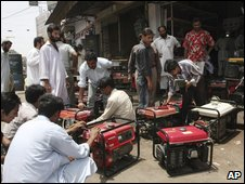 People get their generators fixed at a shop in Karachi, Pakistan on Thursday, June 18, 2009.