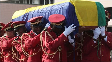 The coffin of Gabonese President Omar Bongo is carried by pallbearers