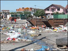Children play in the rubbish strewn across the camp
