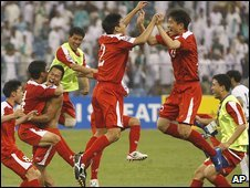 North Korea players celebrate qualifying for the 2010 World Cup