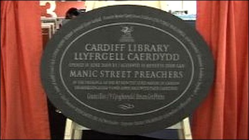 Plaque reads: Cardiff Library, Llyfrgell Caerdydd opened by the Manic Street Preachers
