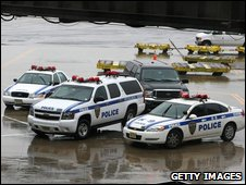 Police cars sit on the tarmac near Continental Airlines Flight 61 at Newark Liberty International Airport on Thursday