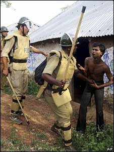The police clashing with villagers outside Lalgarh