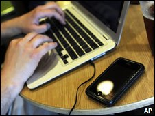 Laptop in coffee shop, AP