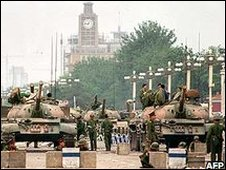 PLA troops guard a strategic avenue leading to Tiananamen Square in June 1989