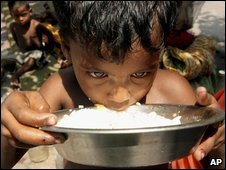 An Indian boy eats rice