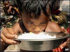 An Indian boy eats rice