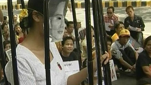 Woman in Suu Kyi mask