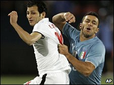 "Italy""s Fabio Quagliarella, right, and Egypt""s Sayed Moawad"