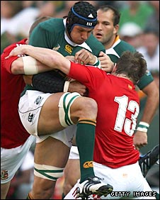 South Africa number eight Pierre Spies tries to power through the tackle of Brian O'Driscoll