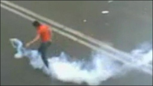 Person kicking gas canister