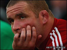 Phil Vickery sits dejectedly on the bench after being replaced