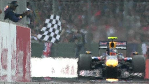 Red Bull&amp;apos;s Sebastian Vettel takes the chequered flag at Silverstone