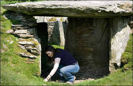 Linda Loughead's daughter Becky examines the false entrance of the Neolithic Burial Chamber at Capel Garmon, Conwy.