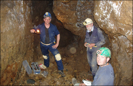 Dave Chapman, Dave Jenkins and Nick Jowett test a prehistoric miners lamp at the Great Orme Copper Mines , about 20 metres below the surface (Andy Lewis).
