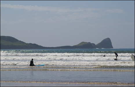 Surfers take to the waves at Rhossili, Gower (Alan Watkins).