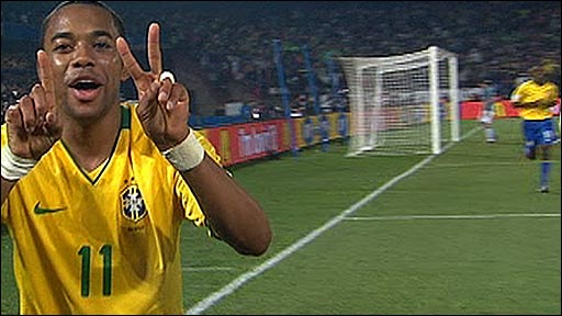 Robinho celebrates Brazil&amp;apos;s third goal against Italy