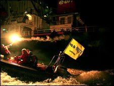 Protesters in a speedboat head towards the freight ship - Pic: Greenpeace