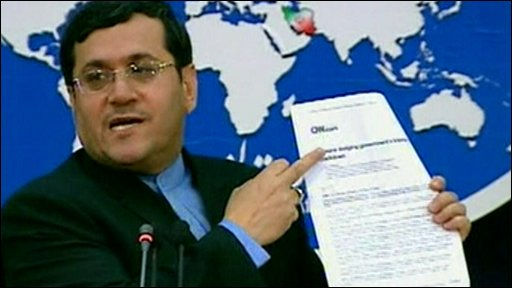Hassan Qashqavi holding what he claims is a handout from CNN to staff on how to hack Iranian government websites