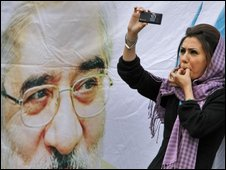 Iranian woman using mobile phone, AP
