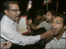 "Pakistani cricket fans share traditional sweets to celebrate their country""s team victory in the final of Twenty20 World Cup against Sri Lanka, in Lahore, Pakistan on Sunday, June 21, 2009"
