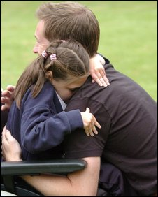 Megan hugging her father Lee (picture: dailypost.co.uk)