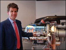 Paolo Carmssi, Honeywell Aerospace president for Europe, the Middle East, Africa and India, with a small engine that powers an aircraft's airconditioning and helps start large engines.