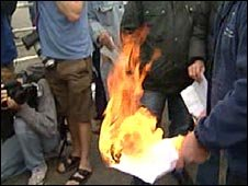 Workers burning dismissal letters