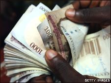 Nigerian Naira, (NGN) being counted in an exchange