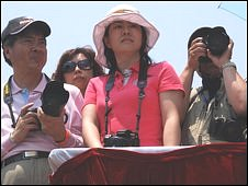 Chinese spectators at a polo match