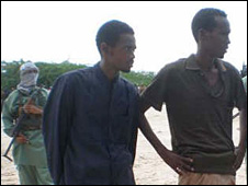 Two of the accused, being guarded