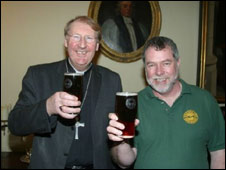 The Bishop of Exeter and Guy Sheppard with two pints of Devon Heaven
