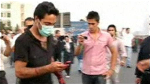 Iranian protester with a mobile phone