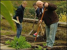 Veterans tending to gardens