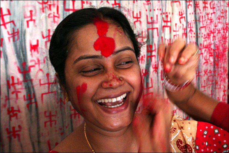 Indian woman having face painted
