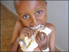 A child eats from a sachet.