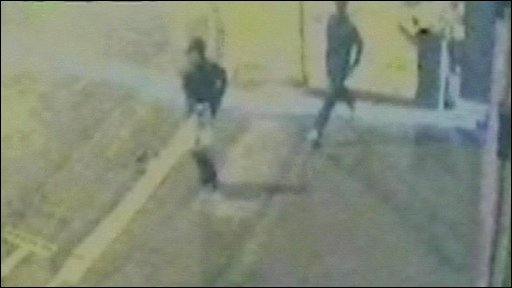 The two men running away after the attack