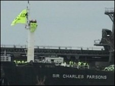 Protesters climb aboard the coal ship