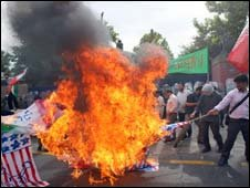 Iranian hardline students burnt the US and British flags outside  the British embassy in Tehran