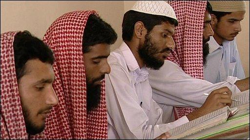 Men in a madrassa
