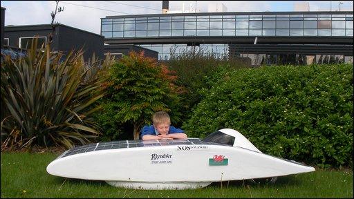 Finnbar with the model solar car outside Glyndwr University