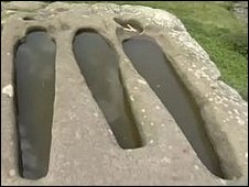 Carved into the rock of the headland are six stone coffins