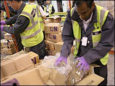 UK Border officers searching cargo at Heathrow 