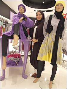 Designer Rabia Z poses with some of her mannequins in a high street collection